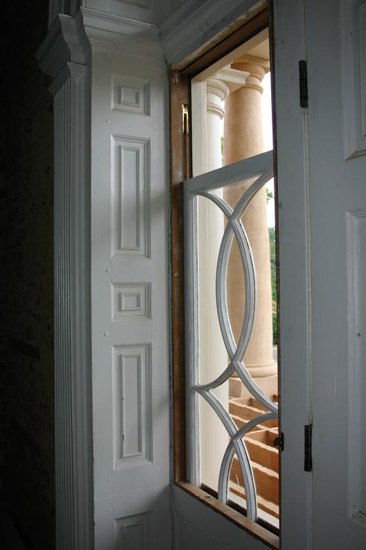 Both of the front door's Venetian sidelights slide down, allowing air to circulate inside the house.