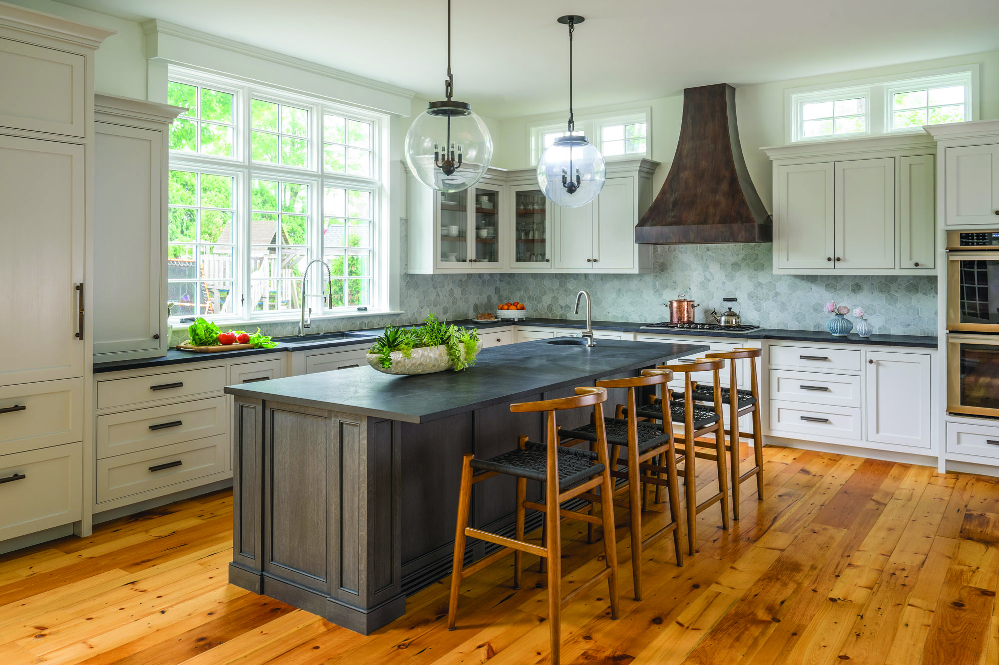 Jewett Farms + Co.'s to creates an updated farmhouse kitchen in an array of gray hues.