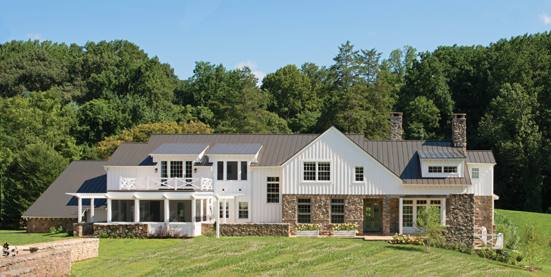 Exteriors of board and batten and fieldstone reflect the home's historical heart.
