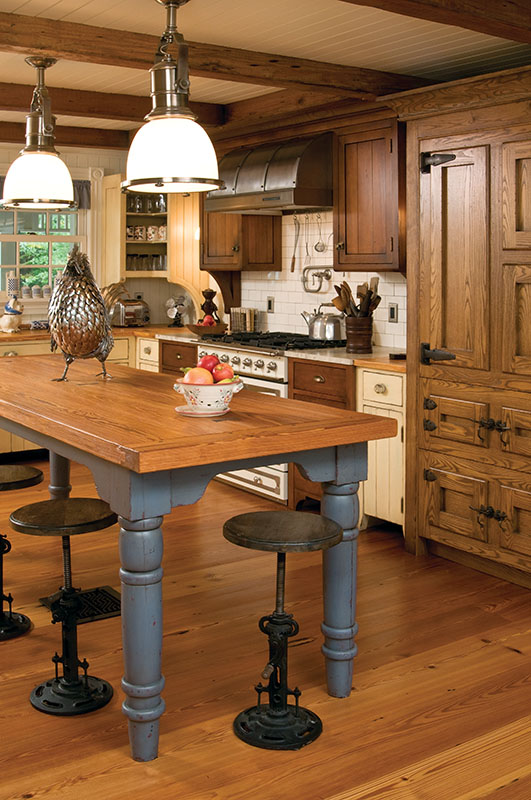 An authentic harvest table features heart pine from the Carolinas.