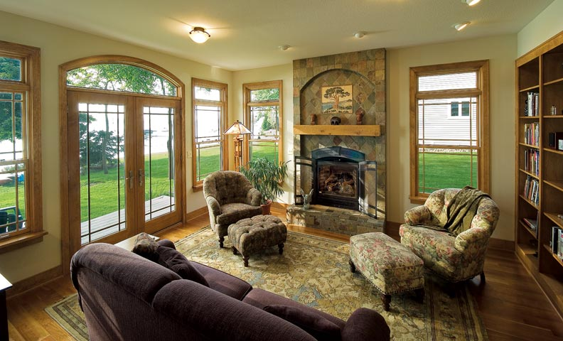 Craftsman touches include grid patterns in the windows and reproduction Arts & Crafts tiles above the fireplace.