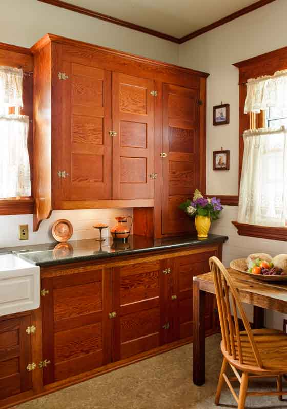 "Keeping original cabinet dimensions meant the family had to forego a built-in dishwasher—""which is no big deal,"" says the owner. Discreet under-counter lighting was added."