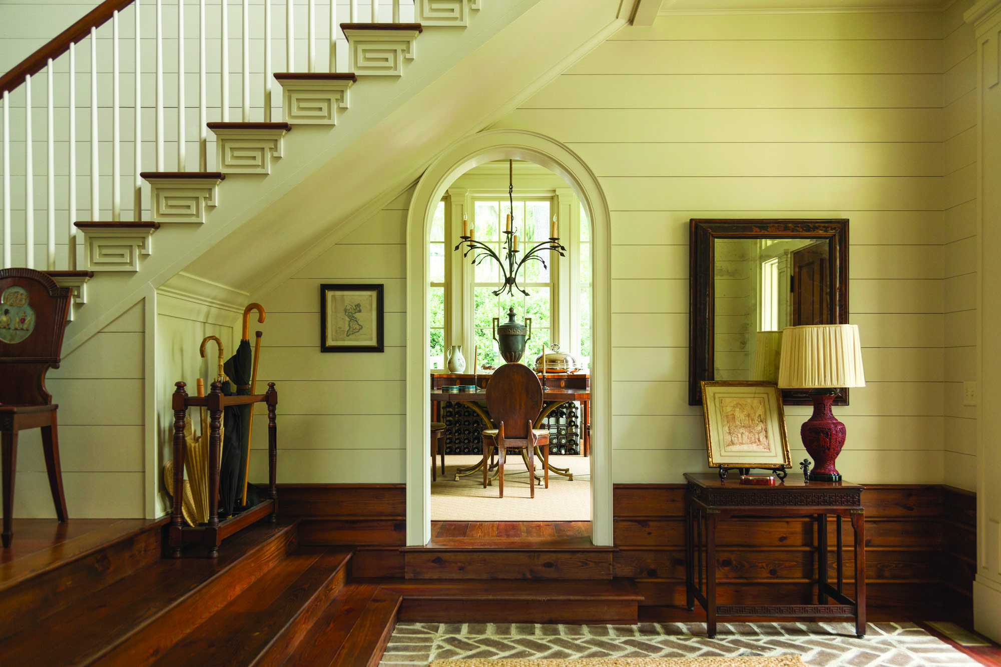 Rooms are filled with flourishes of Greek Revival style.