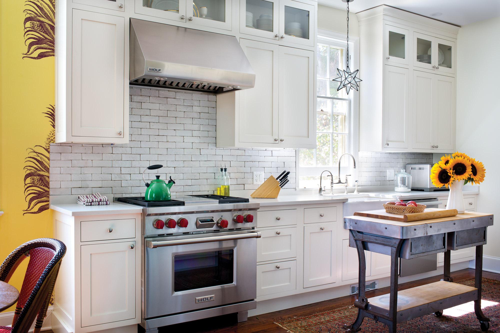 white handcrafted tile backsplash