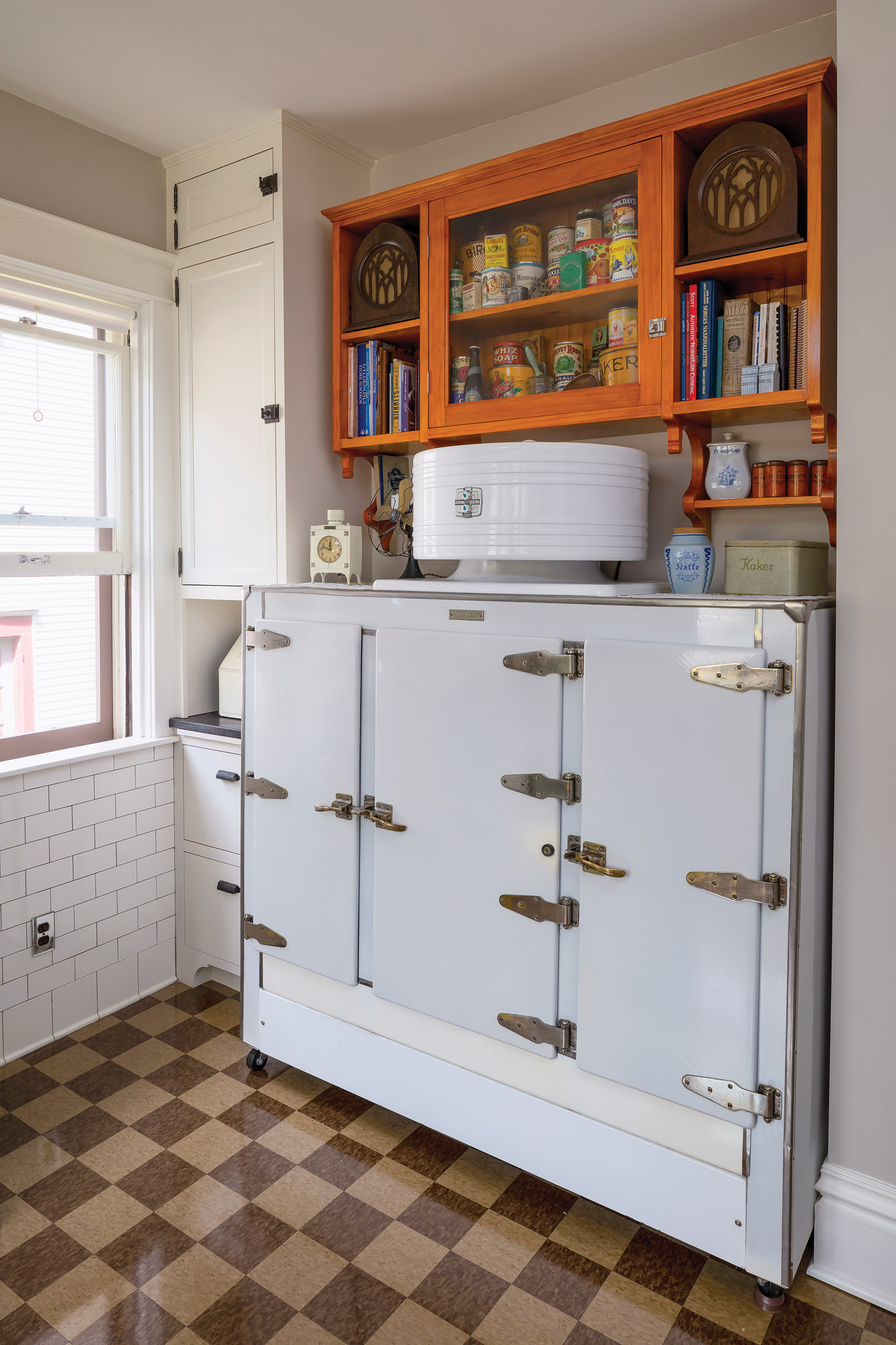 """In the new """"period"""" kitchen, they used antique appliances, lighting, and plumbing fittings, but integrated them with top-of-the-line contemporary elements."""