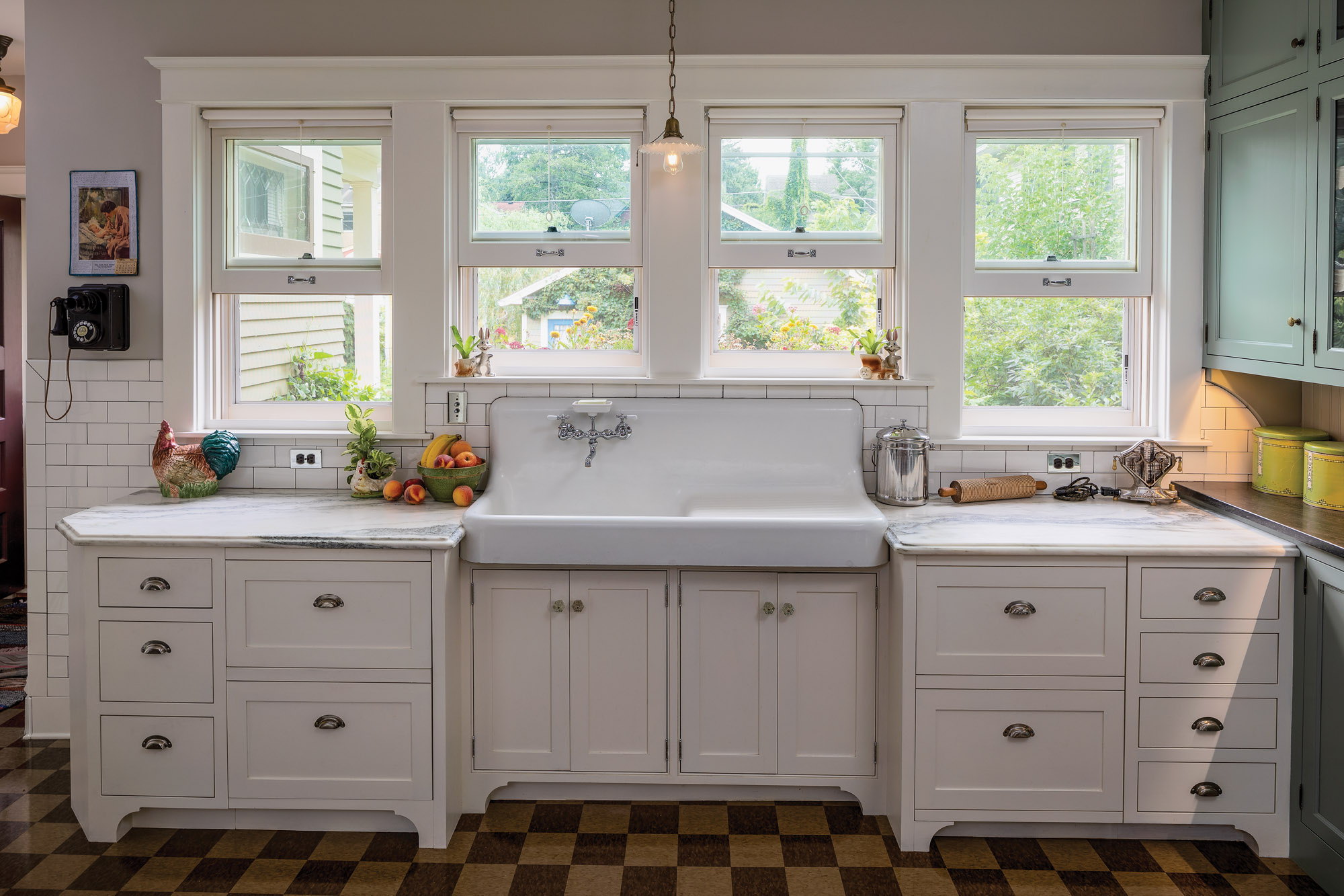 The new windows had to be sized to fit around the sink's high backsplash.