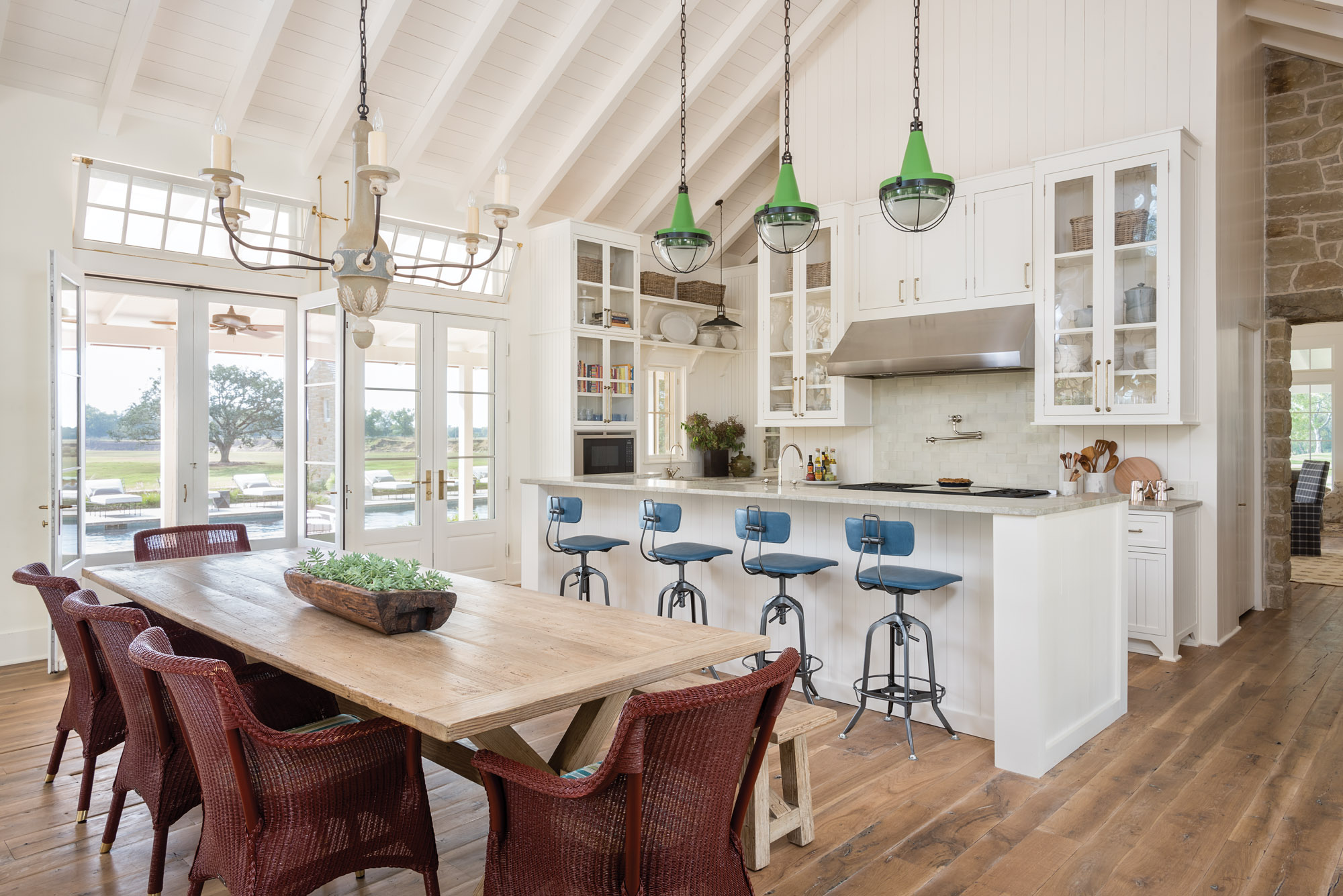 white open kitchen with green pendants