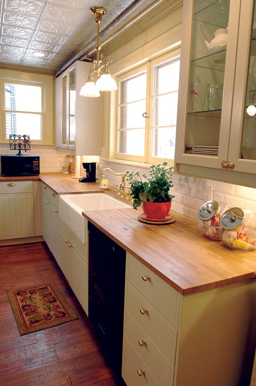 To create a timeless look in their kitchen, homeowners Karen Burghardt and Matt Witchger balanced out their IKEA cabinets with butcher-block countertops and period-inspired hardware.