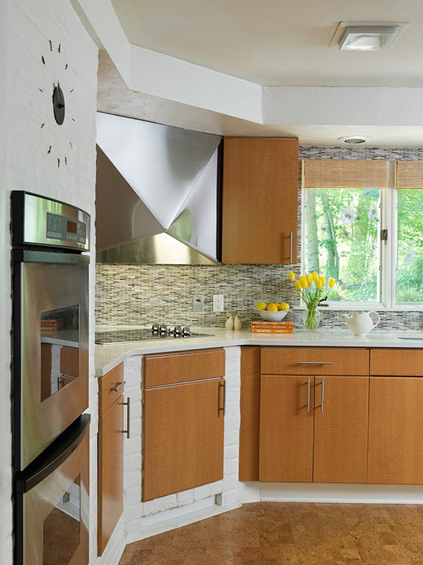 A cork floor warms up the cool tones of a Mid-century Modern kitchen.