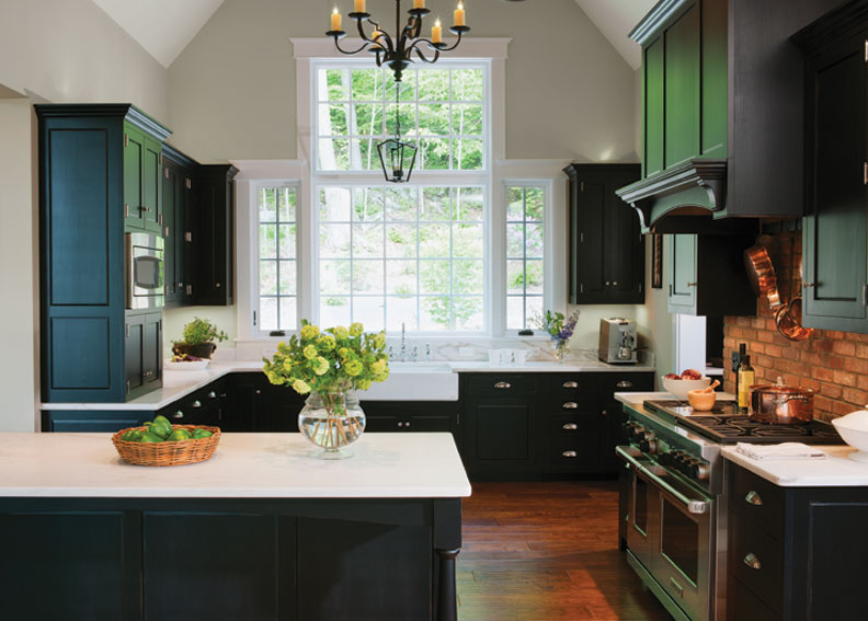 Crown Point Cabinetry designed this kitchen with ample undercounter drawers. The black cabinets are finished in Old Fashioned Milk Paint.