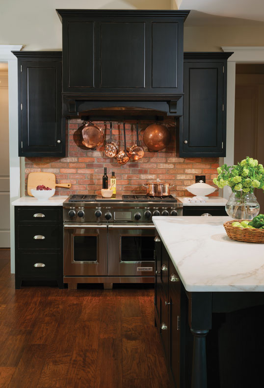 The island in the Crown Point kitchen also offers storage drawers for hiding appliances.
