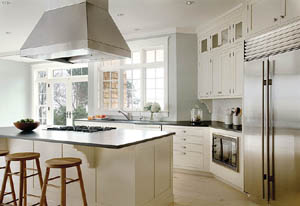 The kitchen blends new and old with stainless steel appliances and traditionally styled cabinets.