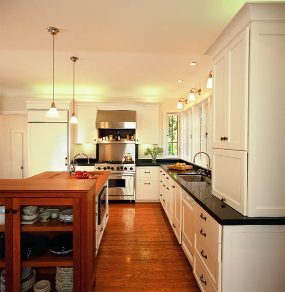 A view of the kitchen island and casement windows beyond designed by Elizabeth Peck Holmes.