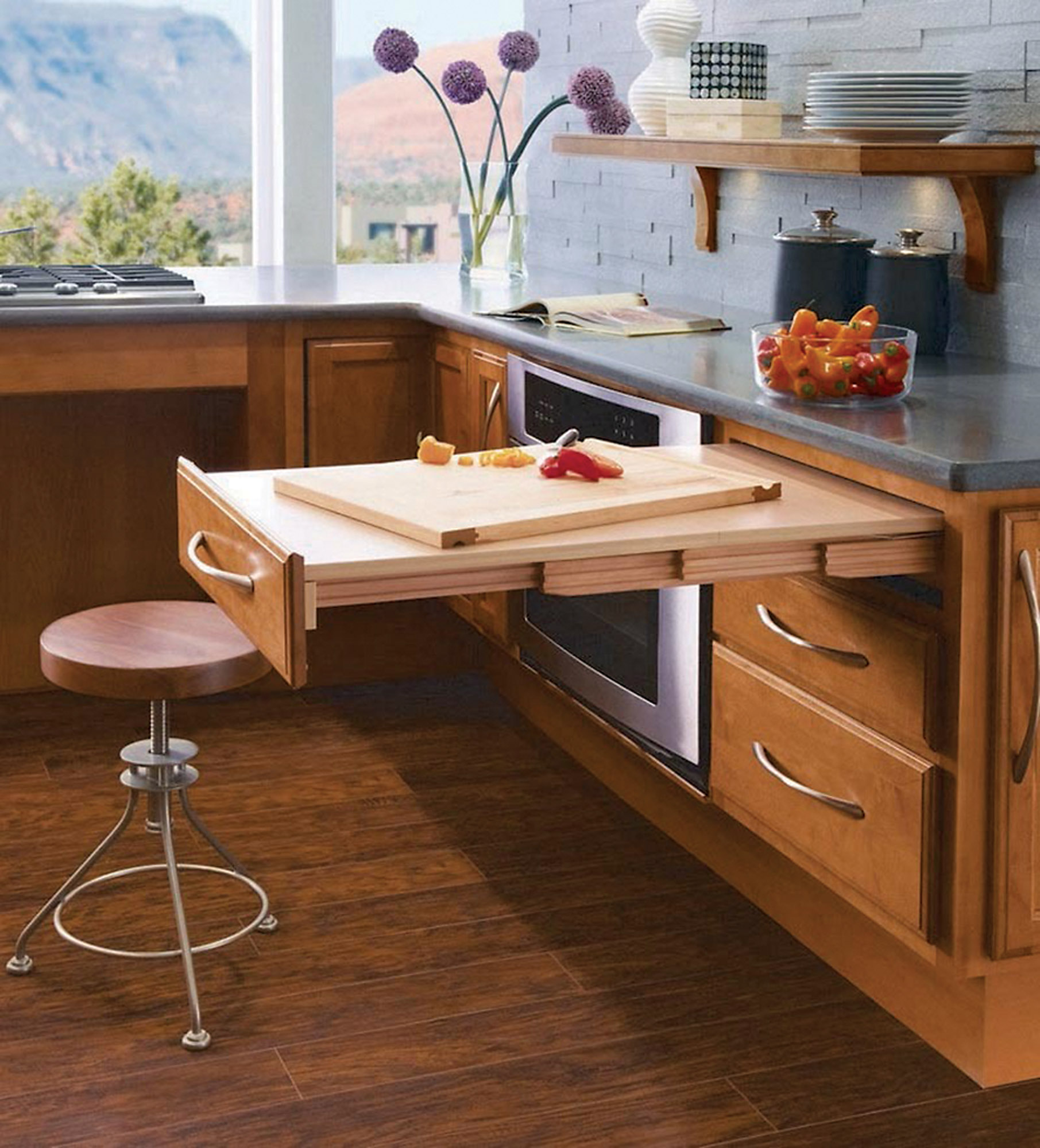 Passport Base pullout table extends at a good height; the company also offers pullout, base-cabinet pantries.