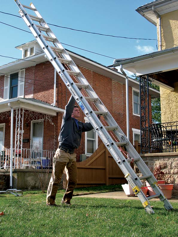 You can move a ladder into an upright position for easy carrying in three steps. Always make sure you map your path—one that's clear of electrical lines and tree branches—beforehand.
