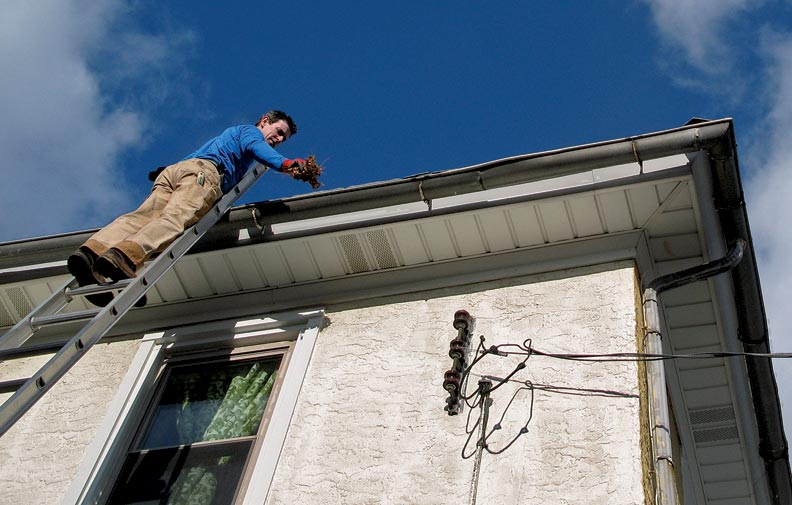 A ladder extended above the roofline makes for easy—and safe—gutter cleaning.