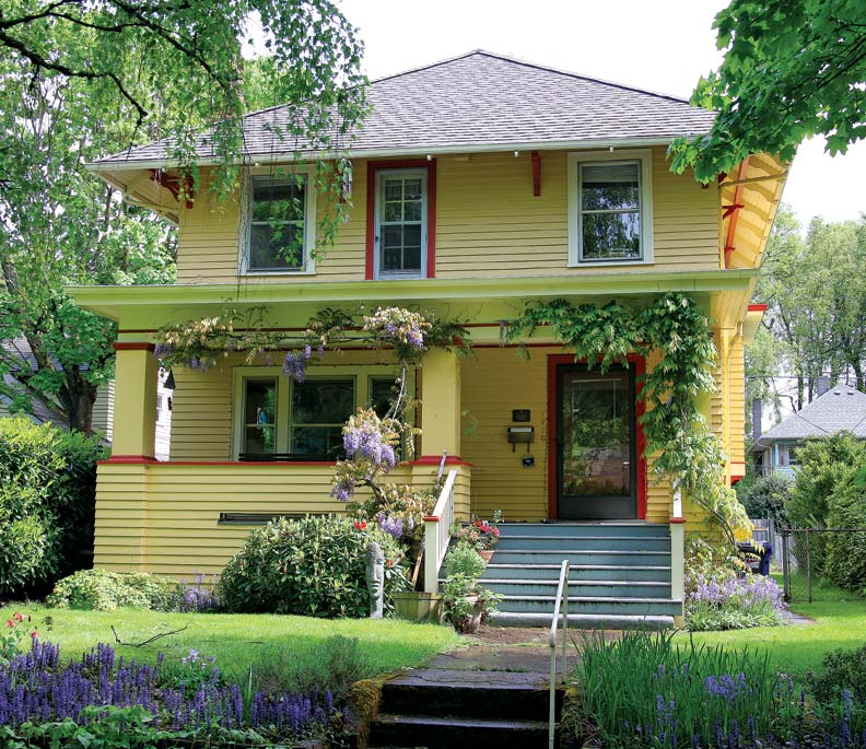 This yellow Craftsman Foursquare contrasts with the grayed tones that predominate in Ladd's Addition.