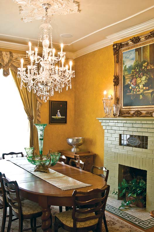 Each room reflects Theresa's love of antiques; the dining room holds two vintage family Singer sewing machines.