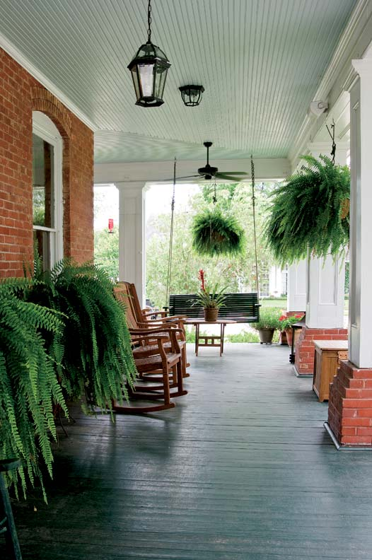 Theresa and Jim Barnatt love to spend evenings on their rebuilt front porch, sitting in the rocking chairs and sipping a glass of wine while watching the sun set over Lake Charles.