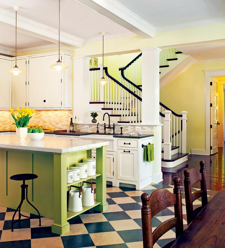 The kitchen is open, bright, and cheery with traditional farmhouse flourishes throughout.