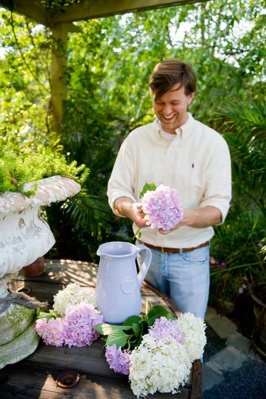 Landscape, floral, and interior designer James T. Farmer III, arranging white 'Annabelle' and 'Forever Pink' blossoms.