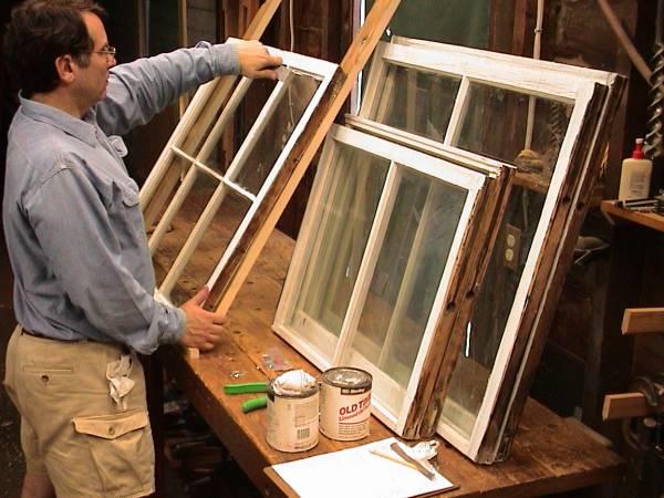 Preservationist John Leeke re-glazes an old sash.