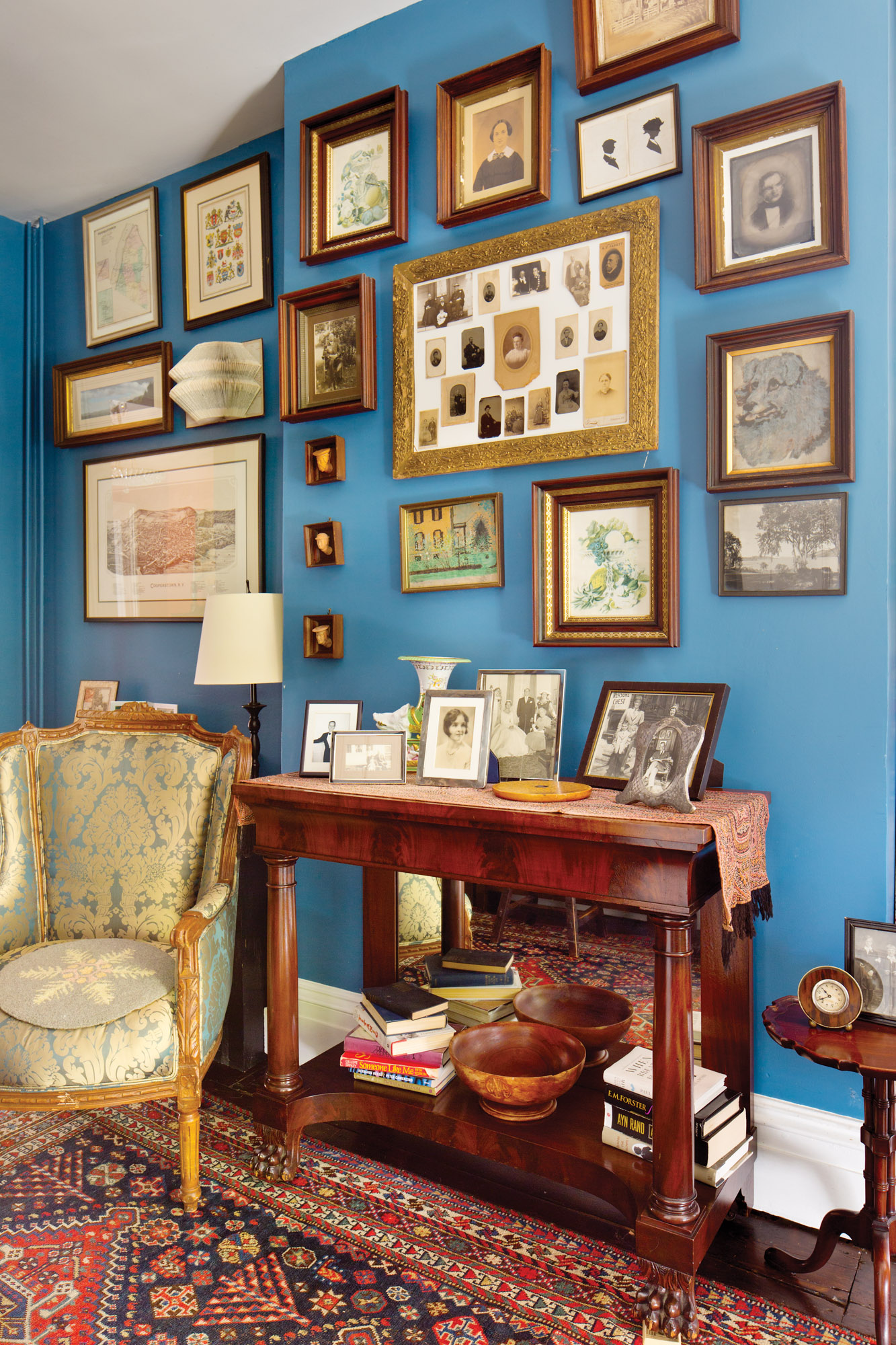 In the library, family photos and artwork going back generations are on display, along with a dog's portrait painted by the owner's great-great-grandmother in 1841.