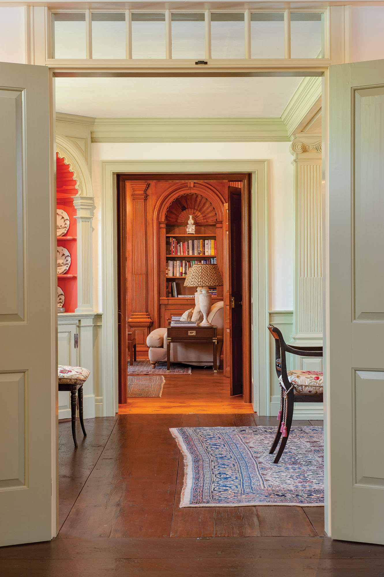 The warm tones of antique woodwork beckon from the library, an 1742 salvaged room appended to the ca. 1735 Georgian-era house.