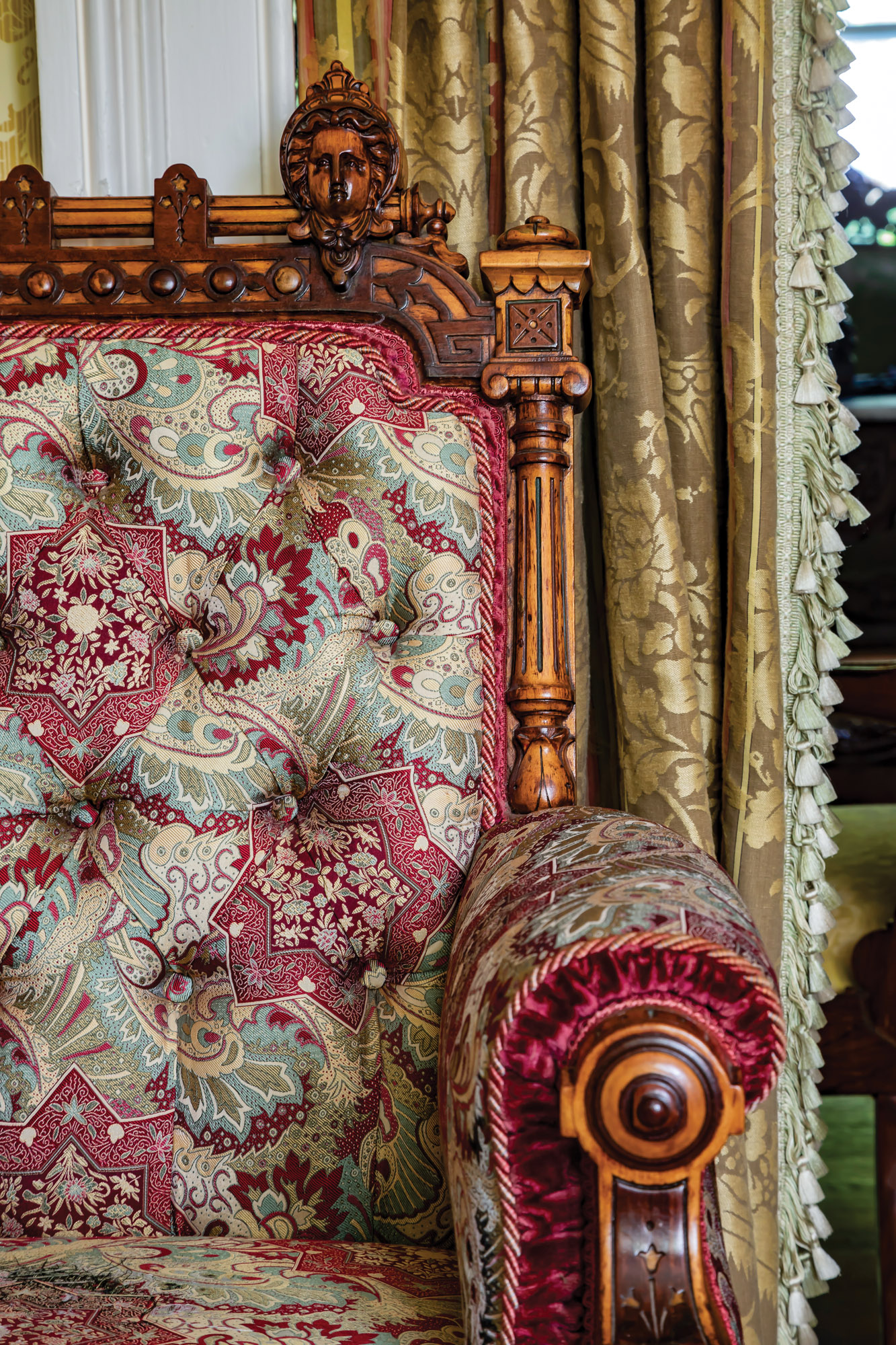 The library–parlor includes Renaissance Revival armchairs with carved crests.