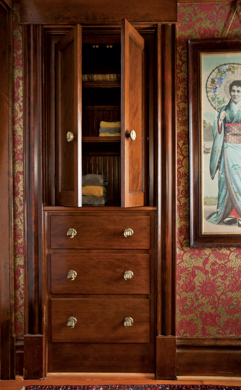 The new cabinet was built into the space once occupied by a hall closet added in the '70s.