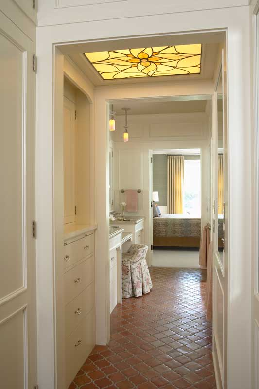 "Linking the bedroom to the bath by way of a ""master hall"" equipped with storage, sinks, and a vanity is an economical use of space in the retrofit of a 1913 historic building by David Heide Design Studio. (Photo: Susan Gilmore)"