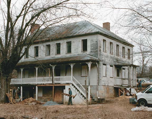 Located in western Maryland, the Rohrbach house is a prosperous farmer's residence that gained its present form in the 1850s with weatherboard siding, refined door and window moldings, and three elegant porches.