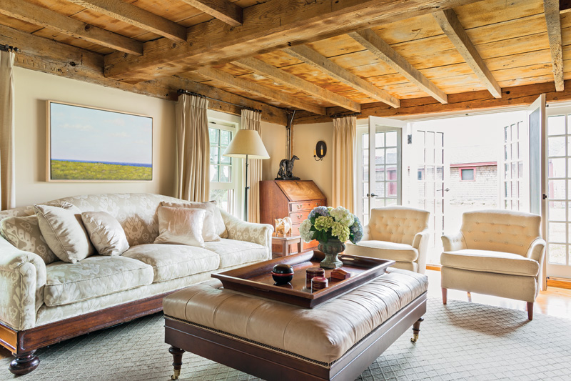 During the 20th century, the parlor ceiling was removed to expose the ancient ceiling beams. French doors were installed in the most recent renovation