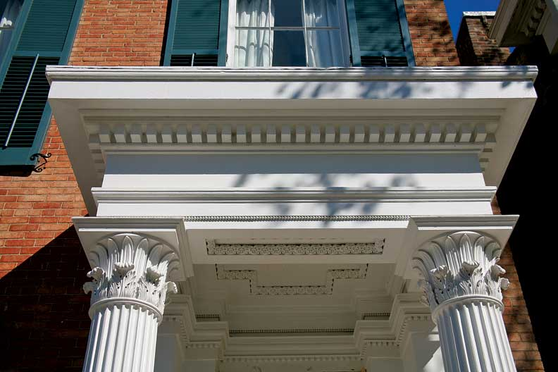 Costigan's own house (1846-49) has a perfect small entrance portico with his signature Greek Corinthian capitals, modified with Egyptian lotus leaves in a distinctive design.