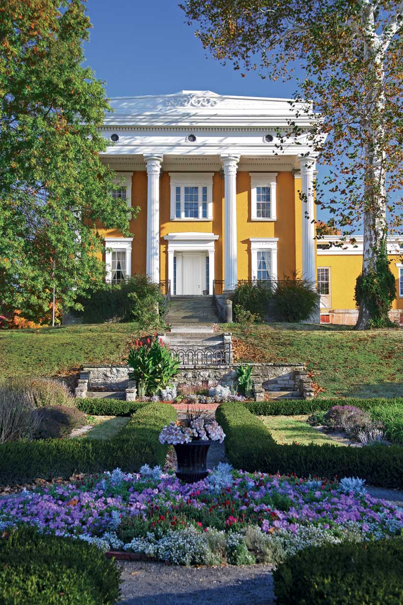 THIS PAGE: The imposing Lanier House, with its grand Greek Corinthian portico, is the masterwork of architect Francis Costigan. It sits high above formal gardens that descend to the Ohio River.