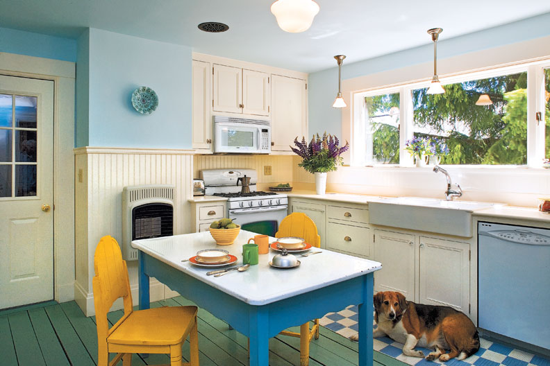 The homeowners decided to keep the large 1970s window for its light and view. A double-bowl apron sink from Ikea has a simple farmhouse look.