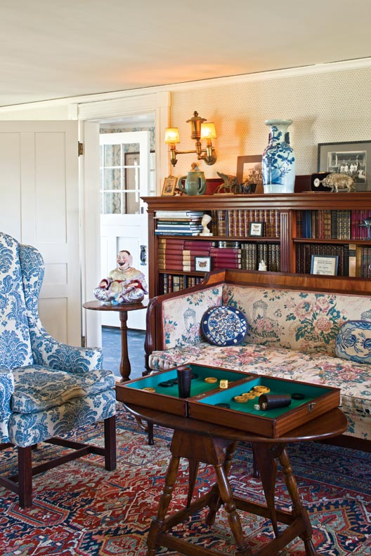 Kim's great-grandmother ordered the settee in the parlor from Macy's, the bookcase from a local cabinetmaker. The wall sconces, originally oil-lit, also date to her era.
