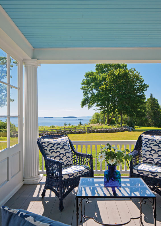 The porch's wicker chairs, made by local craftspeople on Maine's Mt. Desert Island, wear the same blue that has graced the house's outdoor furniture for more than a century.