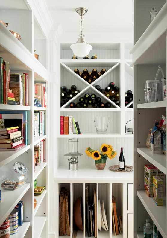 A pantry offers the perfect spot for wine and cookbooks.