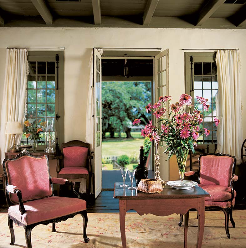 french doors and casements open the house to breezes from the galerie.