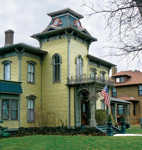 To restore the missing tower on his Italianate house, homeowner Harry Came dreamed up an unconventional plan: Build a new one on the ground and lift it into position.