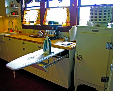 Many early 20th-century built-ins for ironing boards have been turned into shelves, but a pull-out board concealed by a drawer captures the once-revolutionary concept anew. [Photo: Wendi Dunlap]