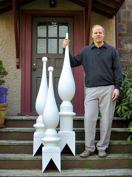 Mario Turchi poses with the new finials, which were copied from a window detail published in Country and Suburban Houses. (Photo: Mario Turchi)