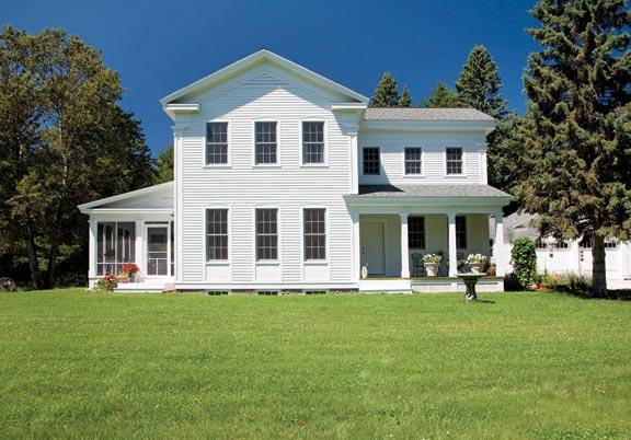 Mark Reuter designed this Greek Revival farmhouse in Michigan's Upper Peninsula.
