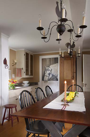 Mary Dacquino kept the most arresting of the trompe-l'oeil paintings of barnyard animals—a horse is painted on the swinging door to the formal dining room.