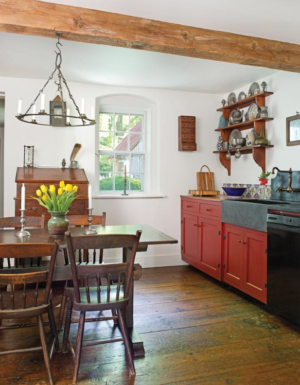 The current owners put a sympathetic kitchen into a gutted portion of the house. Appliances are discreet. Chairs are New England antiques. The floor is reclaimed barn wood.