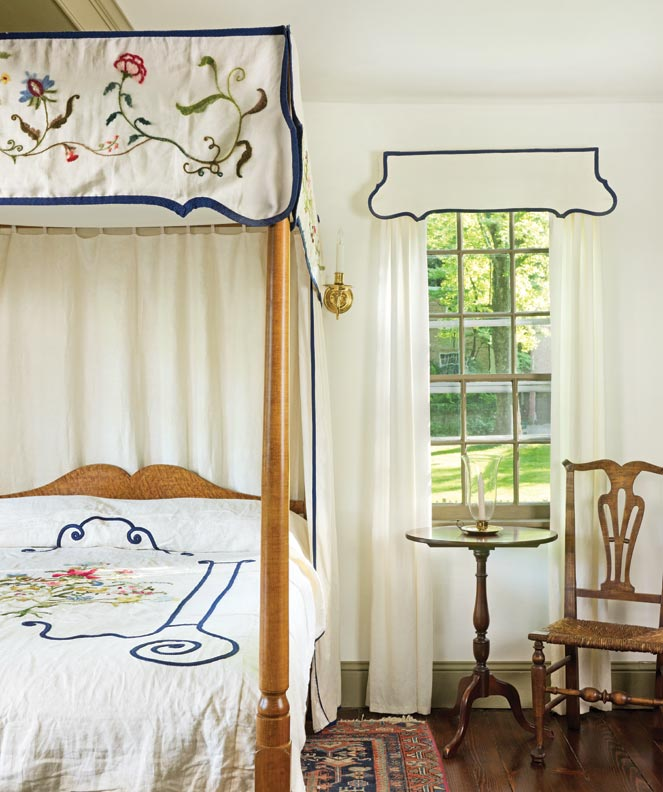 Owner Sandy Heiler designed and embroidered the crewel canopy and cover for the antique bed. The chair is a New England antique.