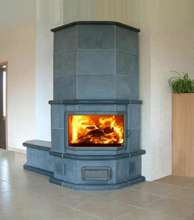 Masonry heaters, like this one from M. Teixeira Soapstone, store and release energy slowly for even, radiant heat.
