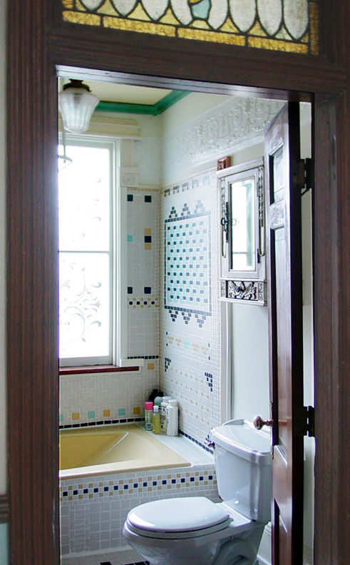Mosaics can even be used to pattern walls, as in this interpretive restoration that integrates 19th-century motifs with a 1970s-era tub that proved impossible to remove.