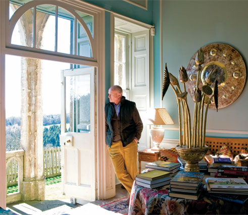 Michael Claydon, Newark Park's current steward, looks out on the Cotswold hills over the south loggia.